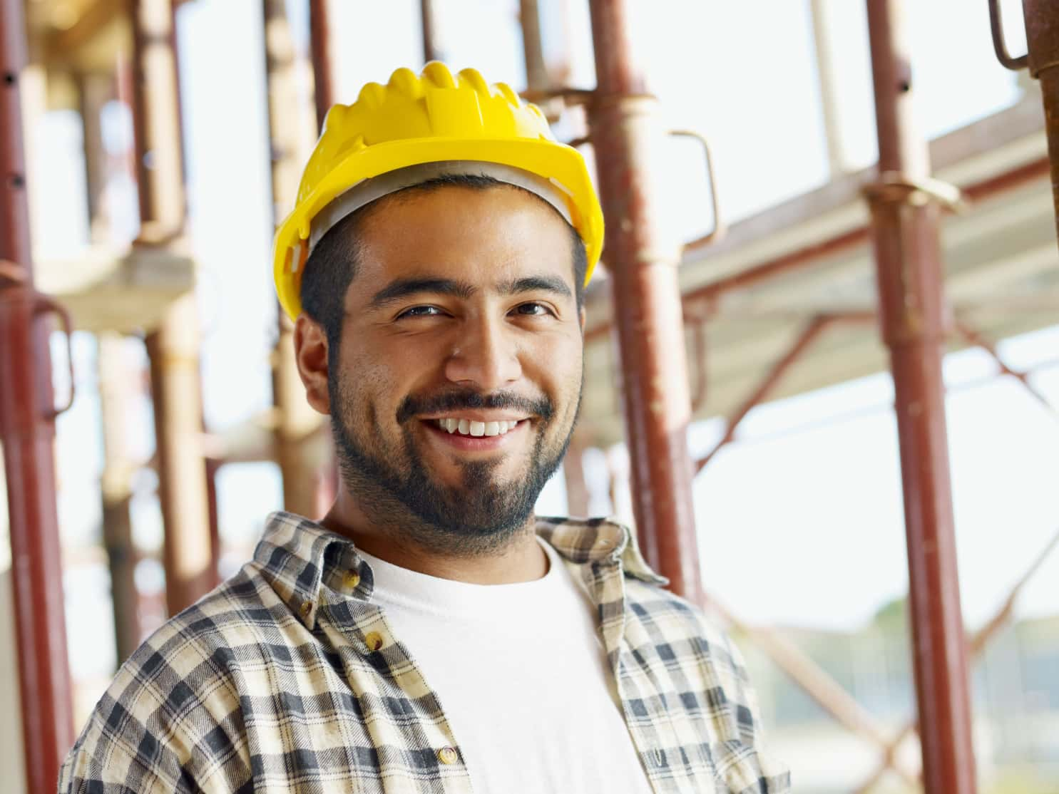 technician yellow hard hat smiling job site